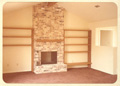 Fireplace and cedar bookshelves at 8214 Argentina